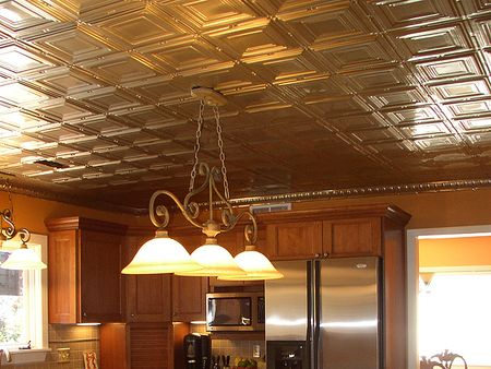 Tin-ceiling-tiles-in-the-kitchen-with-stainless-steel-appliances